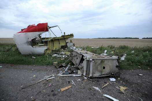 A picture taken on July 17, 2014 shows the wreckage of the Malaysian airliner carrying 295 people from Amsterdam to Kuala Lumpur after it crashed, near the town of Shaktarsk, in rebel-held east Ukraine. Pro-Russian rebels fighting central Kiev authorities claimed on Thursday that the Malaysian airline that crashed in Ukraine had been shot down by a Ukrainian jet. The head of Ukraine's air traffic control agency said Thursday that the crew of the Malaysia Airlines jet that crashed in the separatist east had reported no problems during flight. Photo: DOMINIQUE FAGET, AFP / AFP