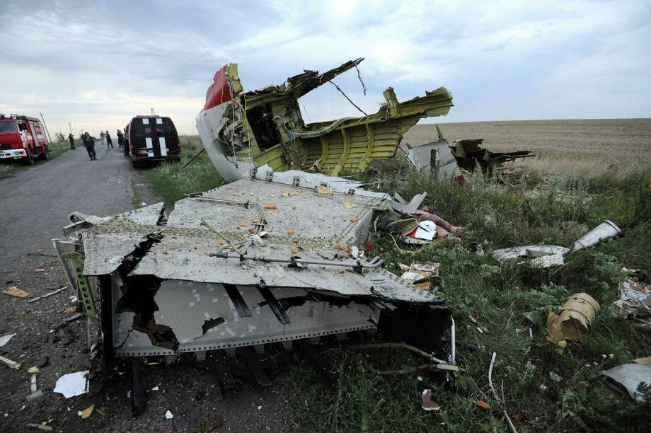 A picture taken on July 17, 2014 shows the wreckages of the malaysian airliner carrying 295 people from Amsterdam to Kuala Lumpur after it crashed, near the town of Shaktarsk, in rebel-held east Ukraine. Pro-Russian rebels fighting central Kiev authorities claimed on Thursday that the Malaysian airline that crashed in Ukraine had been shot down by a Ukrainian jet. The head of Ukraine's air traffic control agency said Thursday that the crew of the Malaysia Airlines jet that crashed in the separatist east had reported no problems during flight. AFP PHOTO/DOMINIQUE FAGET Photo: DOMINIQUE FAGET, AFP / AFP