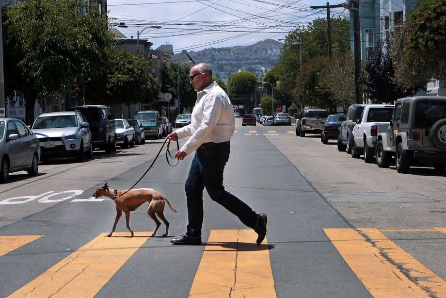 TaskRabbit worker Victor Vela walks whippet Dovima, doing a job that he set up outside TaskRabbit because of his frustration with the San Francisco company's new system for assigning workers to jobs. Photo: Kevin N. Hume, The Chronicle