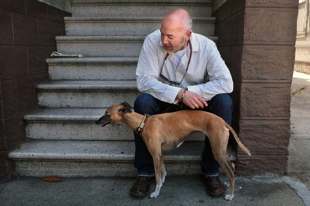 TaskRabbit user Victor Vela sits with whippet Dovima on Wednesday, July 16, 2014 in San Francisco, Calif. TaskRabbit, a site where people can post and accept odd jobs, revamped how workers accept jobs from a bidding system to hourly wages last week. Vela, who achieved