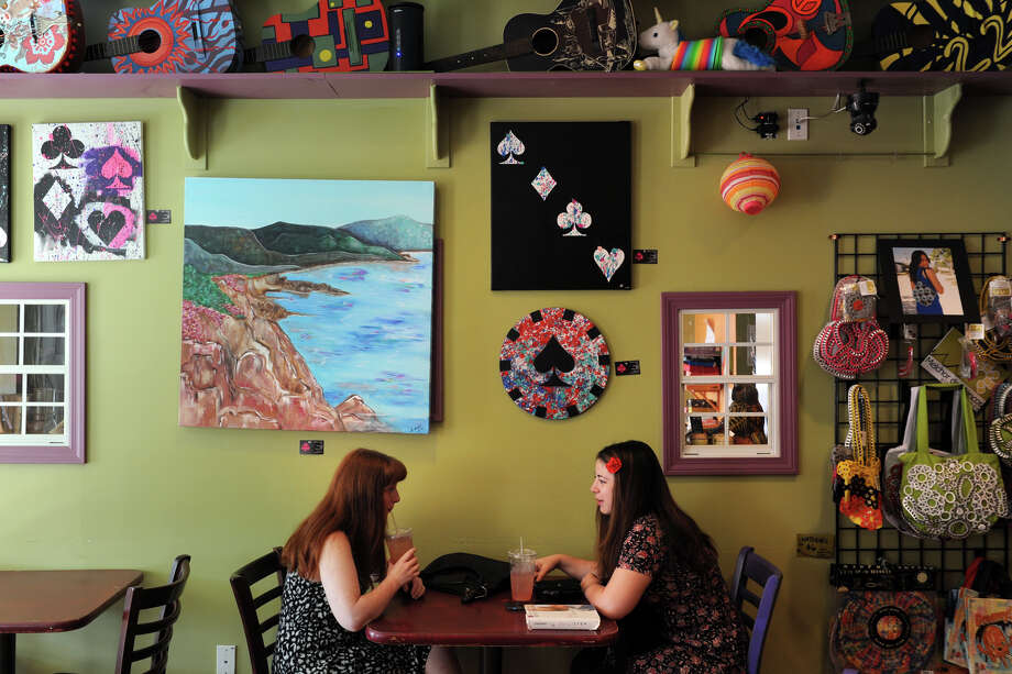 Laura Haessler, left, and Vicotia Piti, both of Danbury, enjoy a quiet morning at Molten Java, in Bethel, Conn. July 17, 2014. Photo: Ned Gerard / Connecticut Post