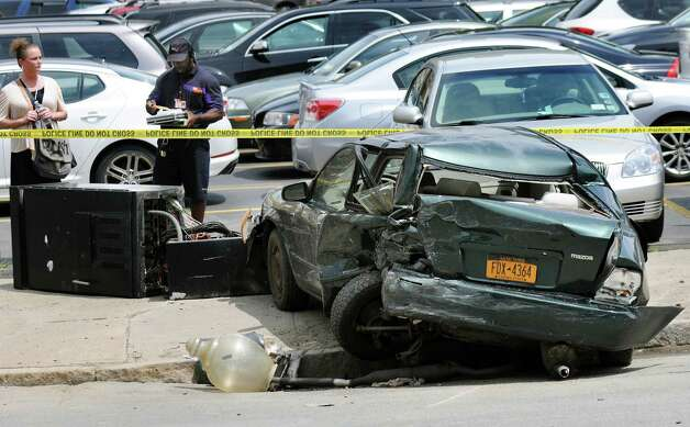 A vehicle that was parked and struck by a motorist on Sheridan Avenue near Chapel Street on Wednesday, July 16, 2014, in Albany, N.Y. (Cindy Schultz / Times Union) Photo: Cindy Schultz