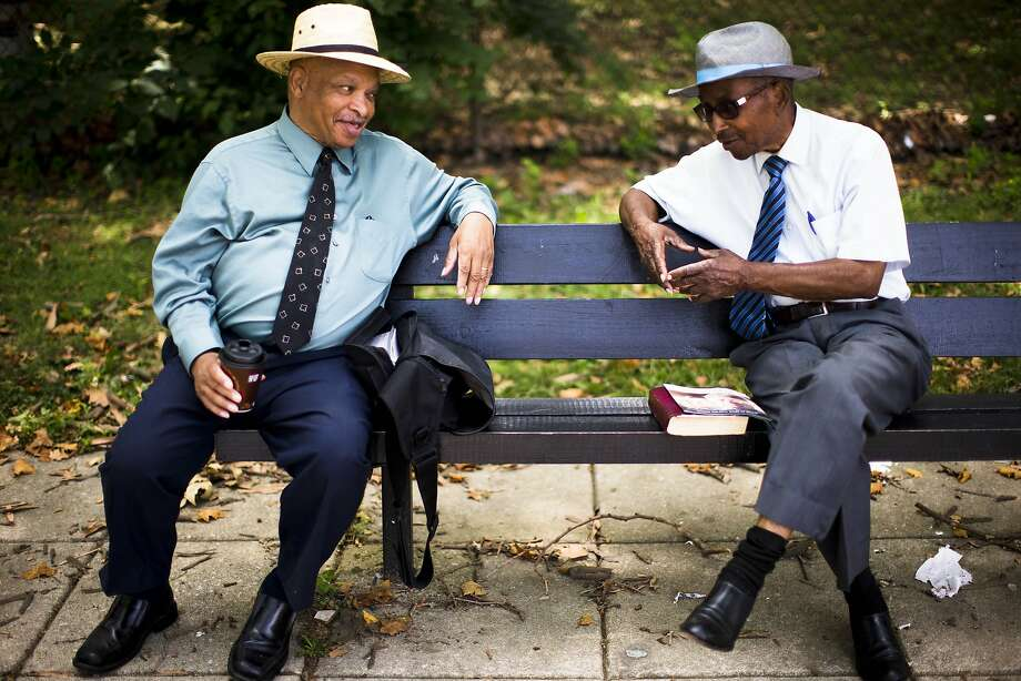 But we want to talk about your hats:In Philadelphia, Jehovah's Witnesses Earl Moore (left) and Thomas 