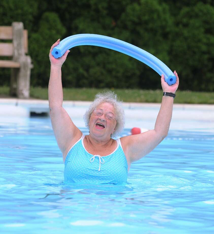 That's using her noodle: Pat Redd sings along with the other swimmers during water 