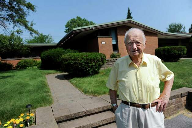Albany architect Harris Sanders stands in front of his home, which he designed, on Wednesday July 2, 2014, in Albany, N.Y. (Cindy Schultz / Times Union) Photo: Cindy Schultz / 00027583A