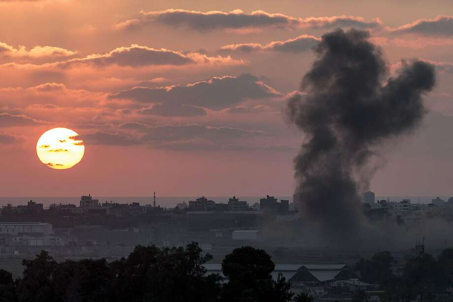 TOPSHOTS A picture taken from the Israeli Gaza border shows smoke billowing from the Gaza Strip following an Israeli air strike on July 16, 2014. Israel intensified its bombardment of Gaza, killing four children on a beach in an apparent naval salvo and launching deadly air strikes, as regional leaders sought to end the killing. AFP PHOTO / JACK GUEZJACK GUEZ/AFP/Getty Images Photo: Jack Guez, AFP/Getty Images