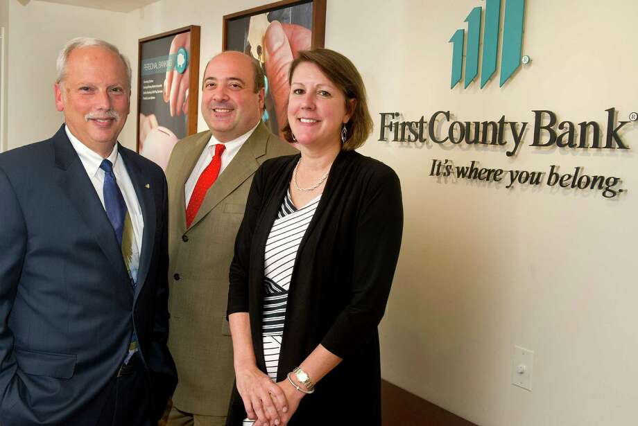 From left, First County Bank Chief Executive Officer Rey Giallongo, Chief Operating Officer Robert Granata, and Corporate Secretary RoseMary Ogden, pose for a photo in Stamford, Conn., on Thursday, July 17, 2014. Photo: Lindsay Perry / Stamford Advocate