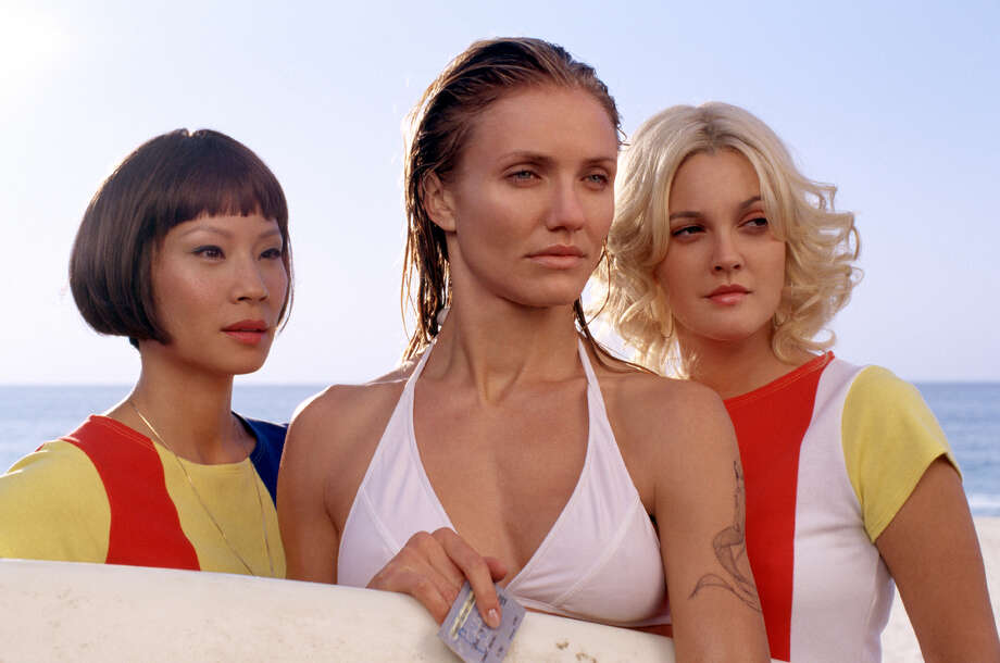 "(l to r) Lucy Liu, Cameron Diaz and Drew Barrymore star in the exciting action sequel ""Charlies Angels: Full Throttle"", a Columbia Pictures release.  (AP Photo/  Darren Michaels) Photo: DARREN MICHAELS / COLUMBIA PICTURES"