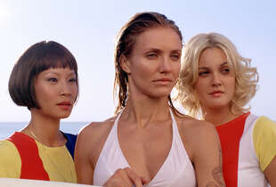 "(l to r) Lucy Liu, Cameron Diaz and Drew Barrymore star in the exciting action sequel ""Charlies Angels: Full Throttle"", a Columbia Pictures release.  (AP Photo/  Darren Michaels)"