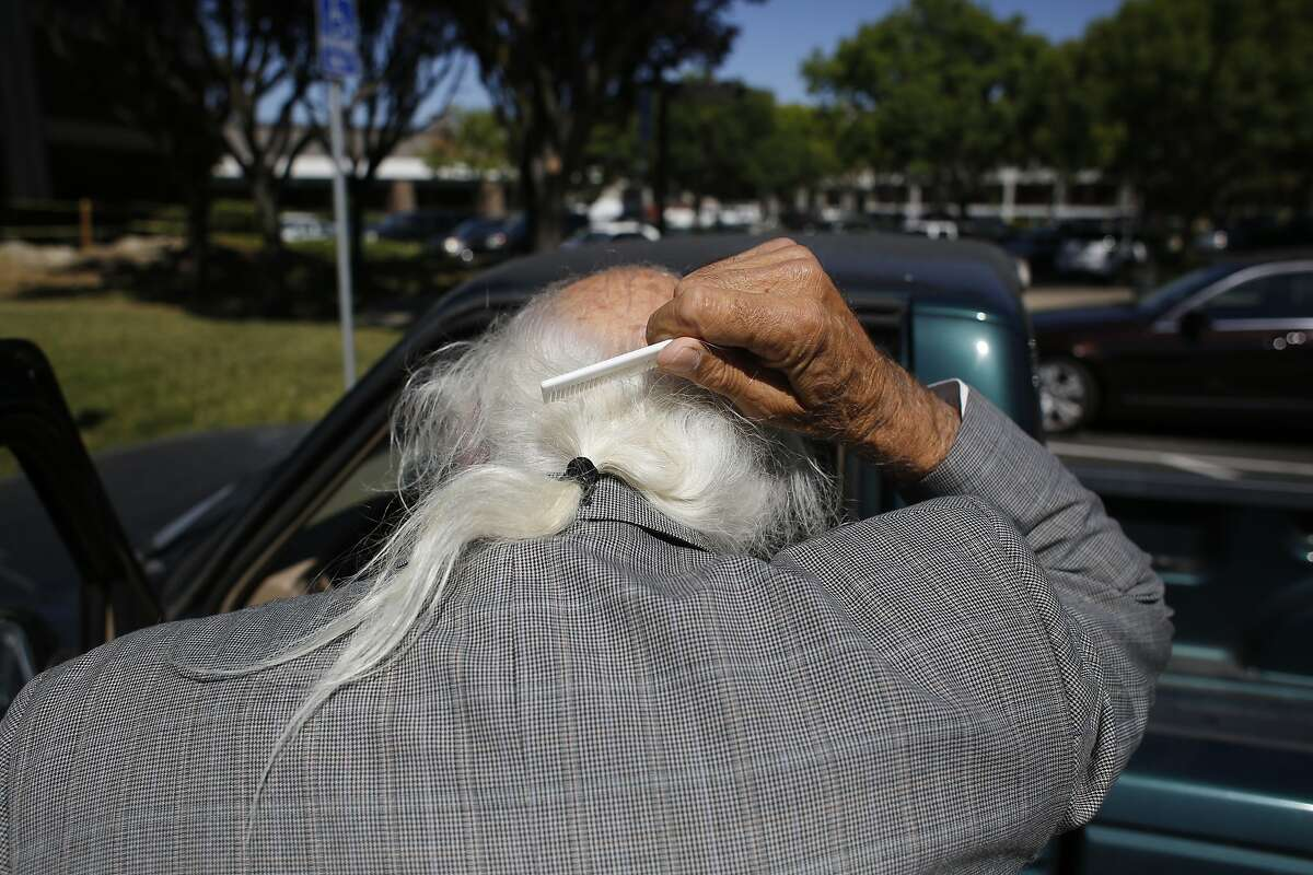"""Famed criminal defense attorney Tony Serra, 79, who is representing Raymond """"Shrimp Boy"""" Chow in the money laundering case that has also ensnared Leland Yee, combs his hear before showing for a different client's arraignment at the Alameda County Superior Court in Pleasanton, Calif. on July 14, 2014."""