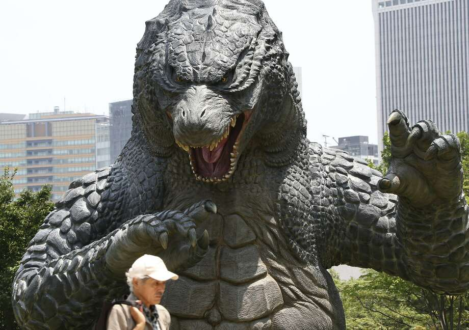 "RRROAR!! HISSS! GRRROWL! ... seriously, nothing? At 60, Godzilla just doesn't terrorize Tokyo like he used to. This is the 60th anniversary of the first ""Godzilla"" movie. Photo: Koji Sasahara, Associated Press"