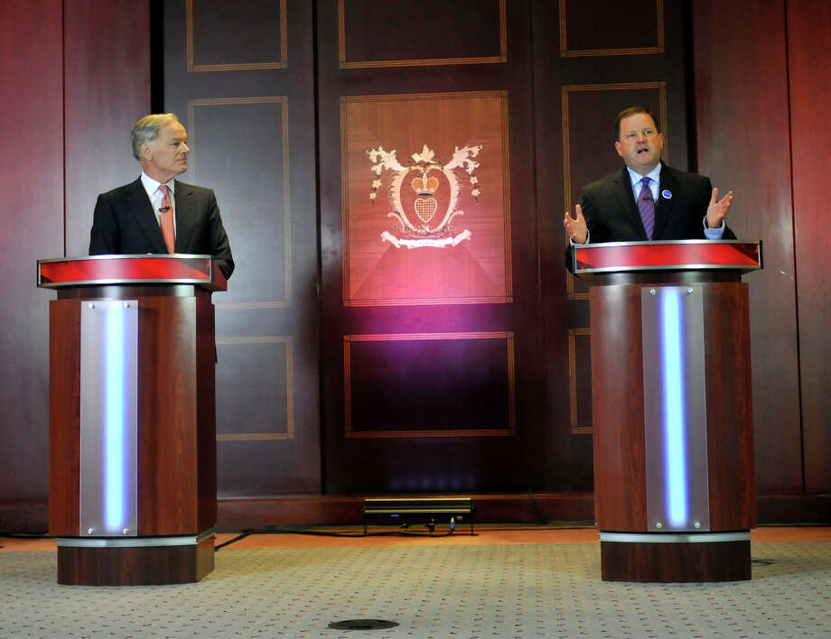 Republlican candidates for governor Tom Foley, left, and John McKinney square off during a debate held at the Hartford Courant building Thursday, July 17, 2014, for the two Republicans running for governor in Connecticut. Foley is a businessman from Greenwich and former U.S. ambassador to Ireland. McKinney, of Fairfield, is the Senate minority leader in Connecticut. Photo: Brad Horrigan, AP Photo/ Brad Horrigan, Pool Ha / AP Photo/Hartford Courant, Brad Horrigan, Pool Associated Press Connecticut Post contributed