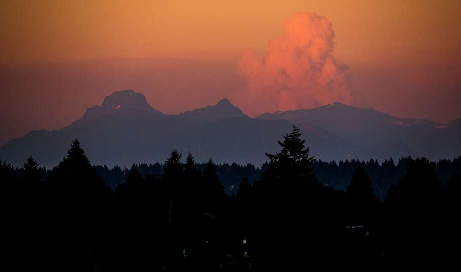 A large cloud rising over wildfires burning in eastern Washington is visible from Seattle. Photo: Joshua Bessex, Associated Press