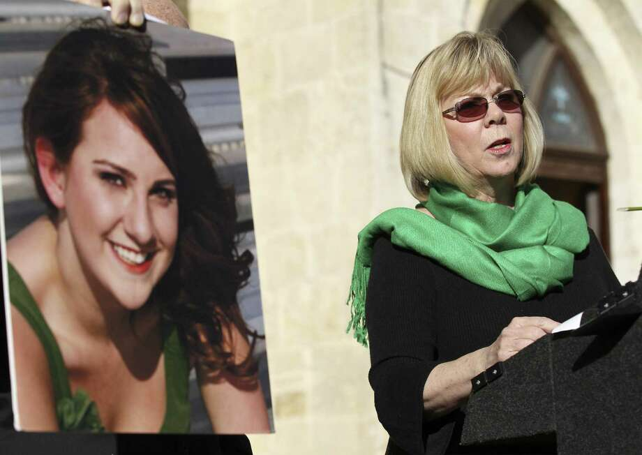 Sandy Phillips, mother of Aurora, Colorado, shooting victim Jessica Ghawi (shown in a photo on left), helps  the group Moms Demand Action at Main Plaza remember victims from the 2012 shooting at Sandy Hook Elementary in Newton, Connecticut. Photo: Kin Man Hui / San Antonio Express-News / ©2013 San Antonio Express-News
