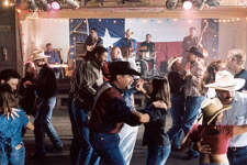 "A dance at Gruene Hall is one scene from the IMAX film ""Texas, the Big Picture."" Two Tons of Steel is performing on stage."