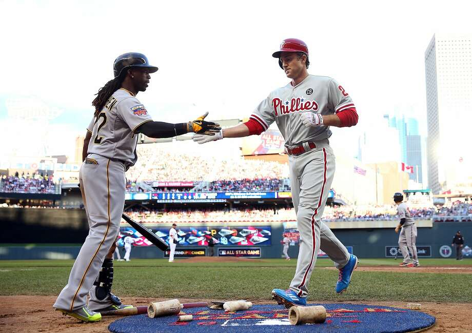 Andrew McCutchen (left) is trying to lead the Pirates back into the playoffs; Chase Utley might be trade bait in Philly. Photo: Elsa, Getty Images