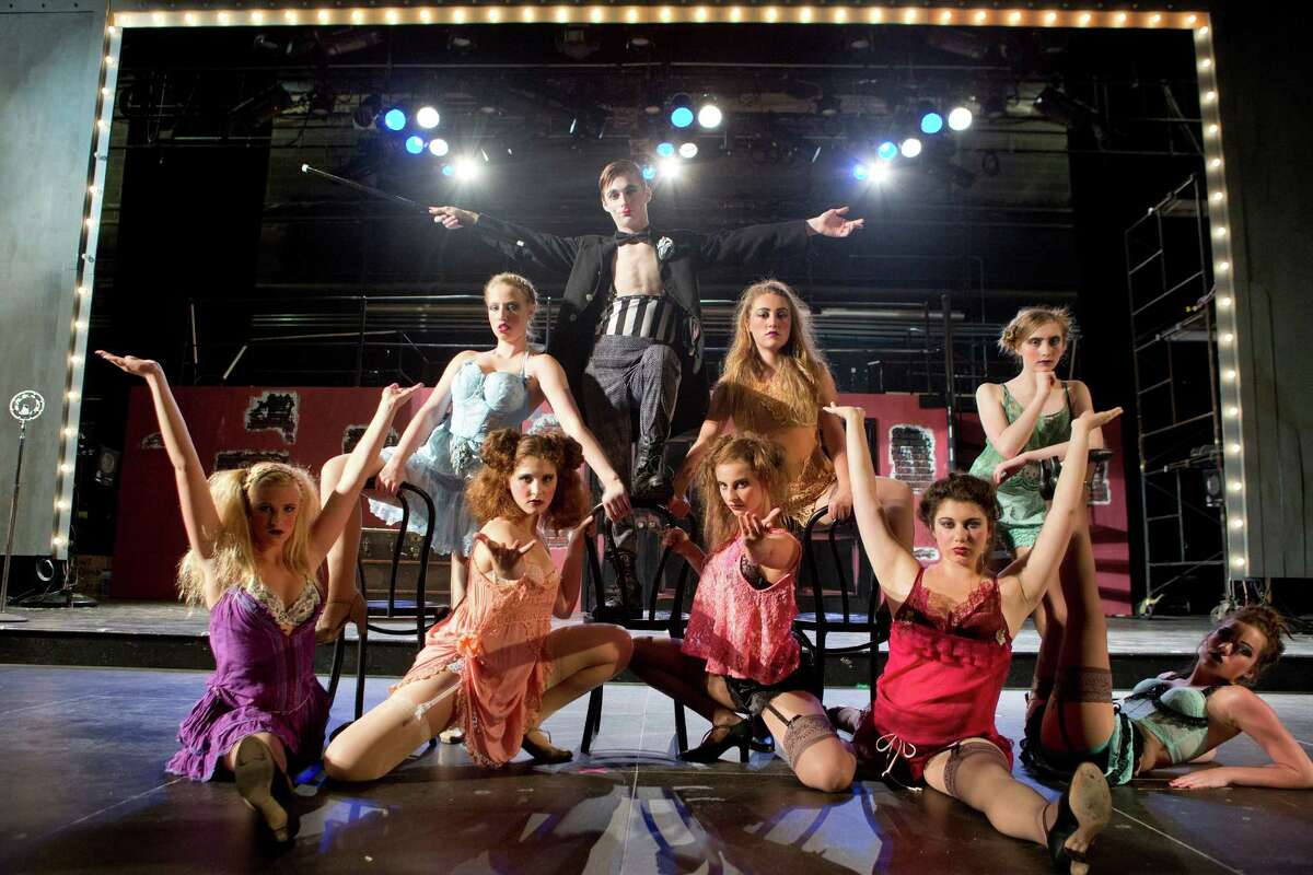 """The girls of the Kit Kat Klub surround the emcee played by Jack Bowman in the Staples Players' production of """"Cabaret"""" from July 24-26."""