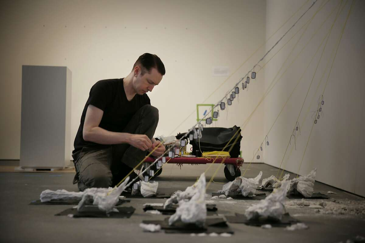 Terrance Graven, Bay Area Art Workers Alliance artist, installs
