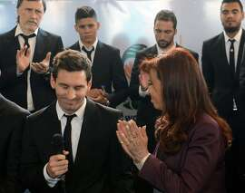 "Handout picture released by the Argentine presidency of President Cristina Fernandez de Kirchner (R) applauding striker Lionel Messi (L) during their welcoming  ceremony from the World Cup where they ended up in second place. AFP PHOTO/PRESIDENCIA/HO   RESTRICTED TO EDITORIAL USE - MANDATORY CREDIT ""AFP PHOTO/PRESIDENCIA/HO"" - NO MARKETING NO ADVERTISING CAMPAIGNS - DISTRIBUTED AS A SERVICE TO CLIENTSHO/AFP/Getty Images"