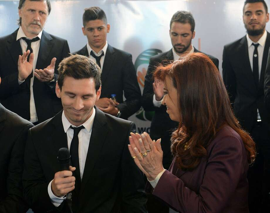 Lionel Messi is welcomed by Argentine President Cristina Fernandez de Kirchner after returning from the World Cup. Photo: Ho, AFP/Getty Images