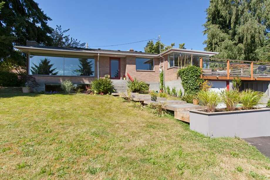 We'll start with the house that's listed for the lowest price of the three on our tour, $429,000, but also has the largest lot, 0.32 acres, 13328 3rd Ave. N.E. The 2,260-square-foot home, built in 1950, has three bedrooms, full and three-quarter bathrooms, a family room, a den, a bonus room and a big driveway with room for an RV and boat. Open houses are scheduled for 2 p.m. to 4 p.m. on Saturday and 2 p.m. to 5 p.m. on Sunday. Photo: Courtesy Joe Bills/Windermere Real Estate