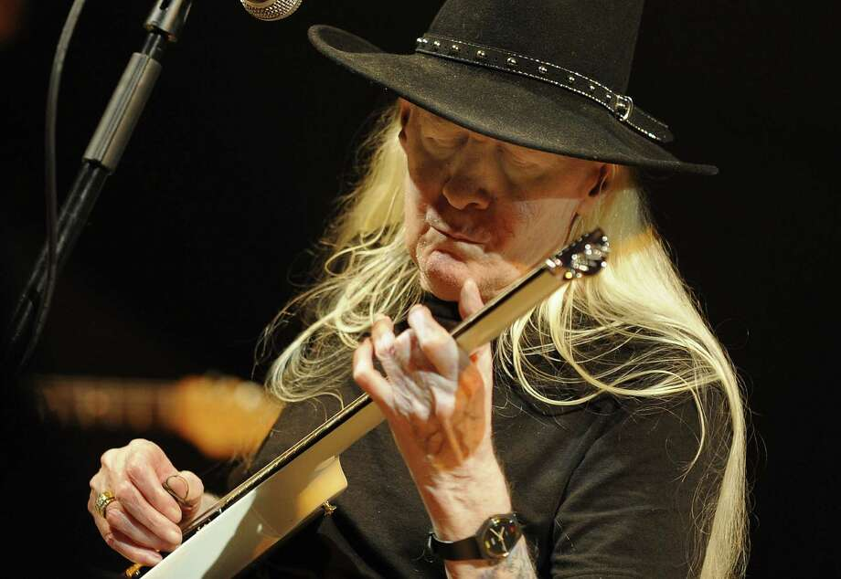 Johnny Winter performs at the 2008 XII Jazz Festival in Valencia's Palau de la Musica. The Texas blues icon died Wednesday at age of 70. Photo: DIEGO TUSON, AFP/Getty Images / AFP