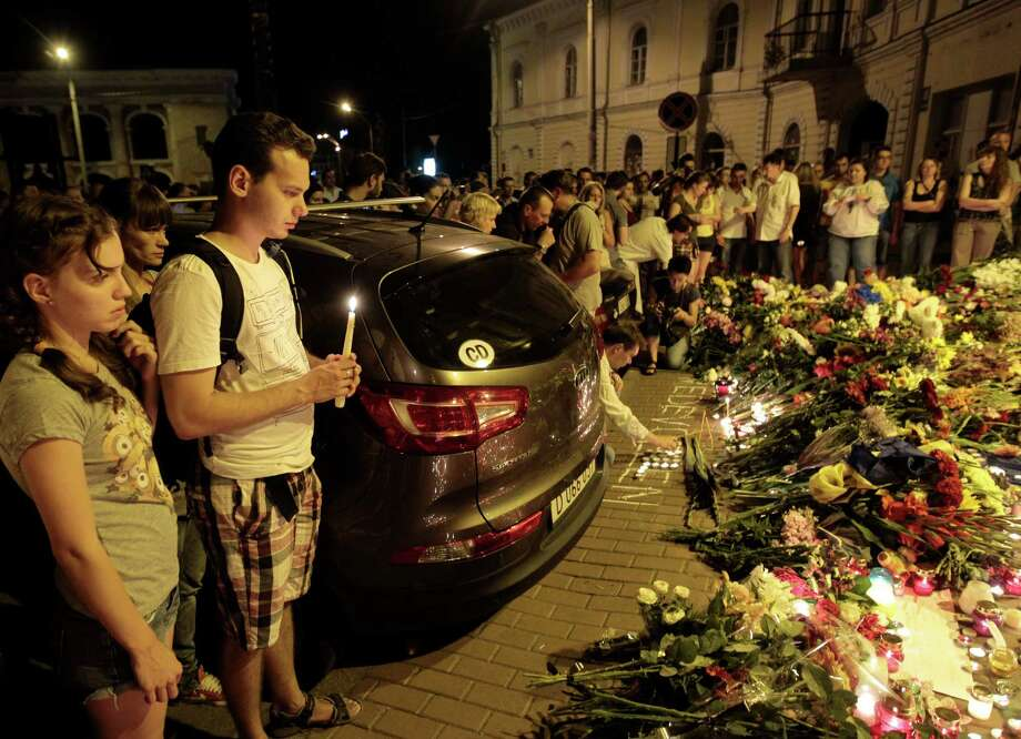 Flower tributes outside the Dutch embassy inKiev, Ukraine,honor the victims of the Malaysia Airlines plane crash on Thursday.  A passenger jet was shot down in eastern Ukraine on Thursday. (AP Photo/Sergei Chuzavkov) Photo: Sergei Chuzavkov, Associated Press / AP