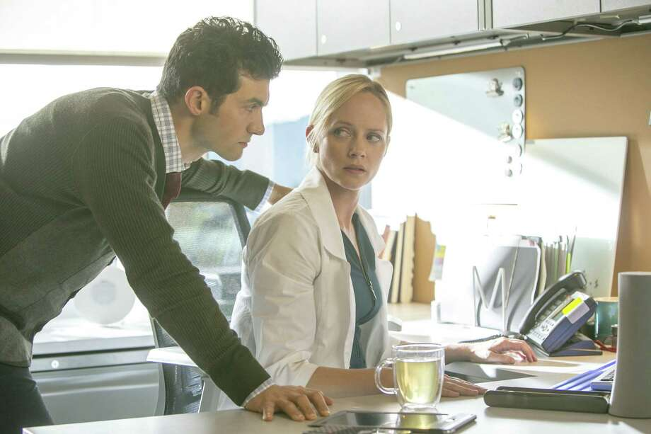 A fertility specialist (Marley Shelton, right) and her assistant (David Alpay) try to find answers in a chilling Lifetime drama set in a bleak future that teeters on the edge of human extinction. The show pilot also takes intriguing peeks into the future. Photo: James Dittiger / Lifetime / C2013 James Dittiger