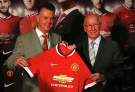 Sir Bobby Charlton (right) helps introduce new United manager Louis van Gaal last summer.