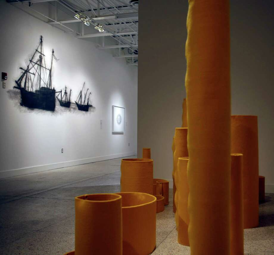 """Material de Exhibición"" by Ricardo Rendón is part of ""Flatland"" at Museo Guadalupe. Mark Hogensen created a smudged charcoal drawing of sailing ships directly on a museum wall for the exhibit. Photo: William Luther / San Antonio Express-News / © 2014 San Antonio Express-News"