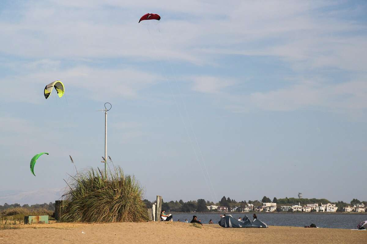 The calm waters and consistent winds of Crown Beach in Alameda make it one of the best places to learn to kiteboard in the Bay Area.