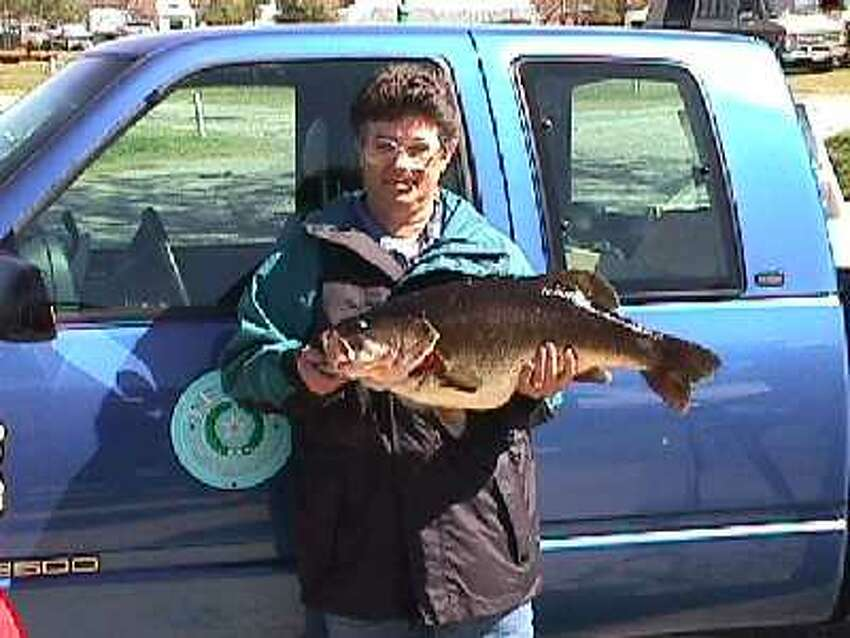 Flo O'Brain and her 16.63 lb fish caught in 1999.