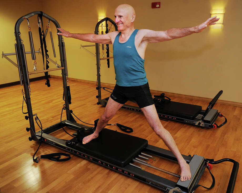 "Jean Francois Bulycz, 78, of Greenwich, performs the warm down exercise ""Side Split"" during Pilates training at New York Sports Clubs at 103 Commerce Road in Stamford, Conn. on Tuesday, July 15, 2014. Photo: Brian A. Pounds / Connecticut Post"