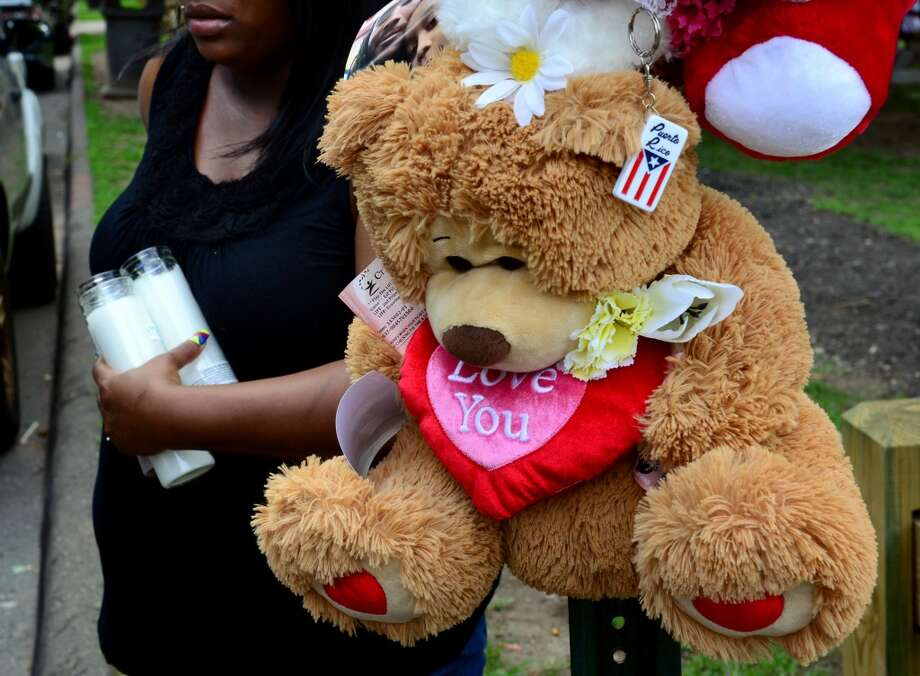 A memorial for murder victim Joseph Myers on Jefferson Street in Bridgeport, Conn. near where Myers was brutally shot in the back of his head while he sat in the back of his Honda Civic on Wednesday July 16, 2014. Photo: Christian Abraham
