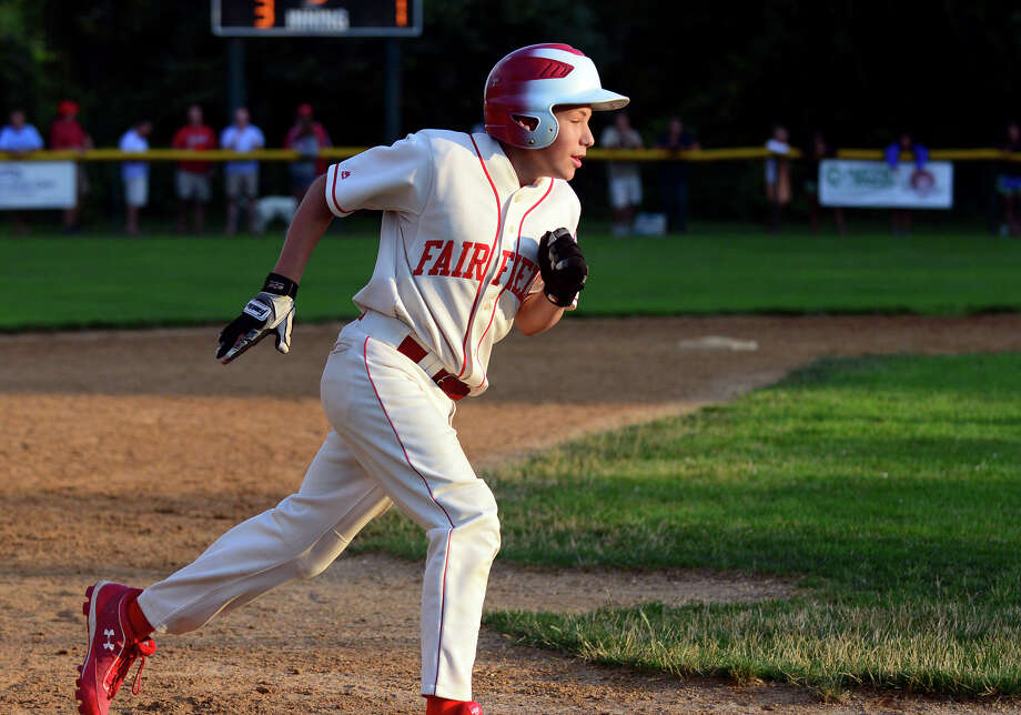 Fairfield American's Vince Camera rounds third on his way to home plate after hitting a home run, during little league sectional tournament action against Norwalk at Old Tavern Park in Orange, Conn. on Thursday July 17, 2014. Photo: Christian Abraham / Connecticut Post