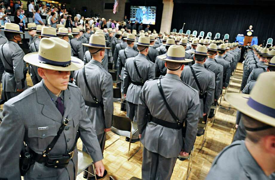 One hundred and sixty-eight new state Troopers march into graduation exercises at the Empire State Plaza Convention Center Thursday, July 17, 2014, in Albany, N.Y.  (John Carl D'Annibale / Times Union) Photo: John Carl D'Annibale / 00027742A