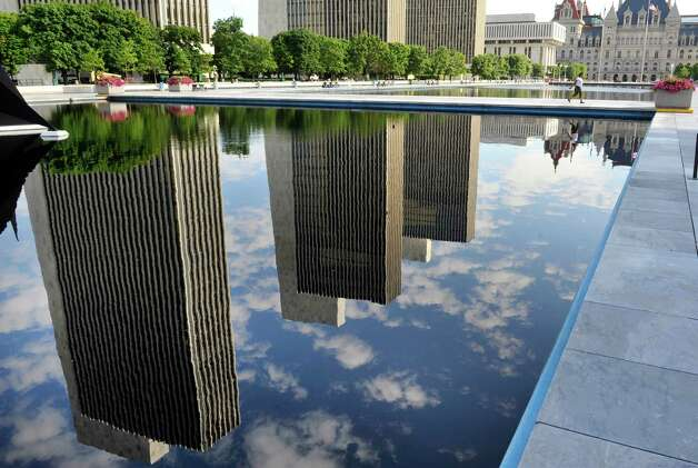 The agency buildings are seen reflected in one of the pools on the Empire State Plaza on Thursday, July 17, 2014, in Albany, N.Y.     (Paul Buckowski / Times Union) Photo: Paul Buckowski