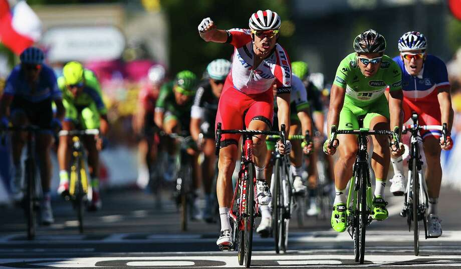 Norway's Alexander Kristoff exults after winning Stage 12 of the Tour de France, a 115.5-mile jaunt from Bourg-en-Bresse to Saint-Etienne. It was Kristoff's first Tour stage victory. Photo: Bryn Lennon / Getty Images / 2014 Getty Images