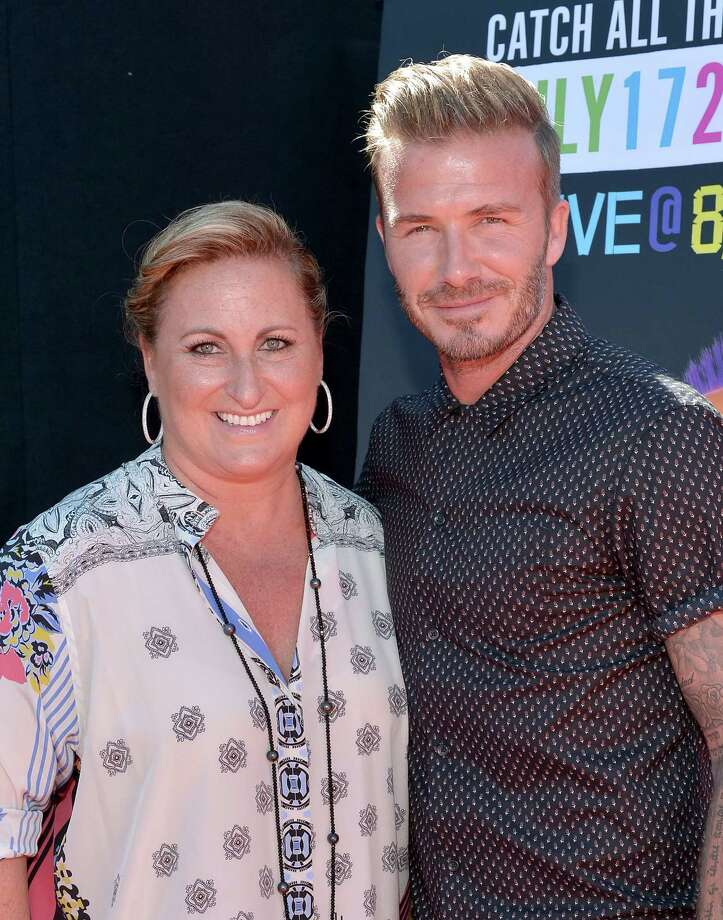 Nickelodeon and MTV Networks' Kids & Family Group President Cyma Zarghami, left, and former soccer player David Beckham attend Nickelodeon Kids' Choice Sports Awards 2014 at UCLA's Pauley Pavilion on July 17, 2014 in Los Angeles, California. Photo: Charley Gallay, Getty Images For Nickelodeon / 2014 Getty Images