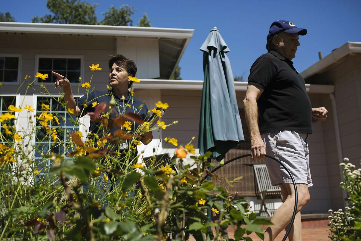 Rachel Garza, left, water conservation technician with East Bay Municipal Utility District, meets with Todd, right, who preferred to omit his last name, to find ways to conserve water at his home in Orinda, Calif. on Thursday, July 17, 2014.