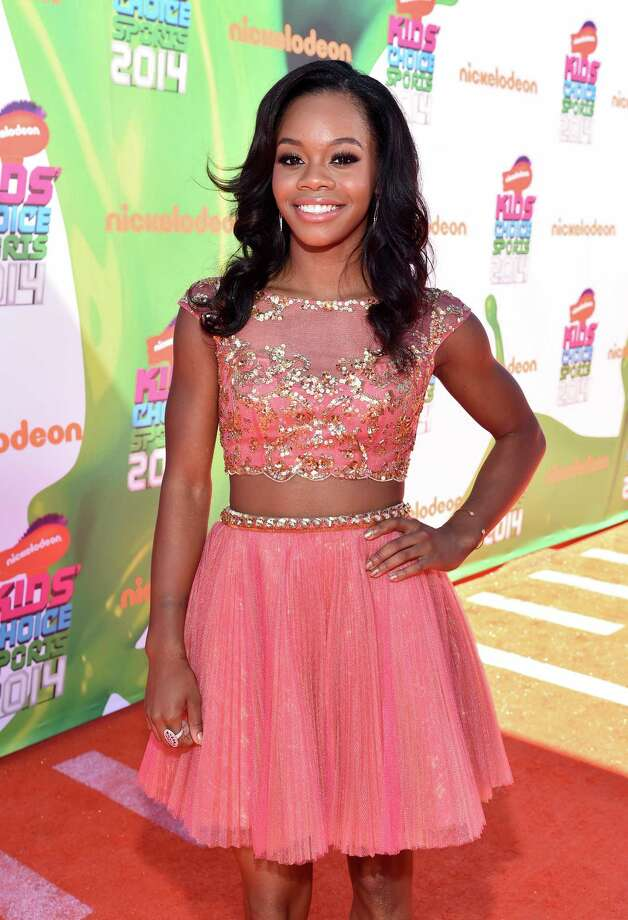 Olympic gymnast Gabby Douglas attends Nickelodeon Kids' Choice Sports Awards 2014 at UCLA's Pauley Pavilion on July 17, 2014 in Los Angeles, California. Photo: Alberto E. Rodriguez, Getty Images For Nickelodeon / 2014 Getty Images