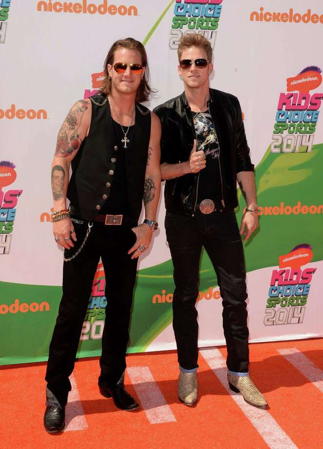 Musicians Tyler Hubbard (L) and Brian Kelley of Florida Georgia Line attend Nickelodeon Kids' Choice Sports Awards 2014 at UCLA's Pauley Pavilion on July 17, 2014 in Los Angeles, California. Photo: Jason Merritt, Getty Images / 2014 Getty Images