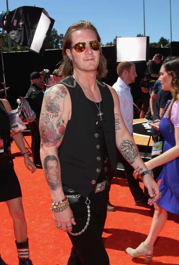 Sports figures flock to nickelodeon houston chronicle for Tyler hubbard tattoos