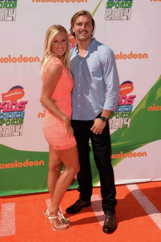 Professional Surfer Bethany Hamilton, left, and Adam Dirks attend Nickelodeon Kids' Choice Sports Awards 2014 at UCLA's Pauley Pavilion on July 17, 2014 in Los Angeles, California. Photo: Jason Merritt, Getty Images / 2014 Getty Images