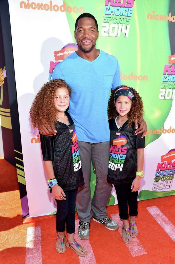 Isabella Strahan, left, TV personality Michael Strahan and Sophia Strahan attend Nickelodeon Kids' Choice Sports Awards 2014 at UCLA's Pauley Pavilion on July 17, 2014 in Los Angeles, California. Photo: Alberto E. Rodriguez, Getty Images For Nickelodeon / 2014 Getty Images