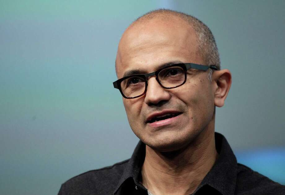 FILE- In this May 20, 2014 file photo, Satya Nadella, CEO of Microsoft, talks during the introduction the Surface Pro 3 tablet device at a media preview in New York. Microsoft on Thursday, July 17, 2014 announced it will lay off 18,000 workers over the next year. (AP Photo/Mark Lennihan, File) Photo: Mark Lennihan, STF / AP