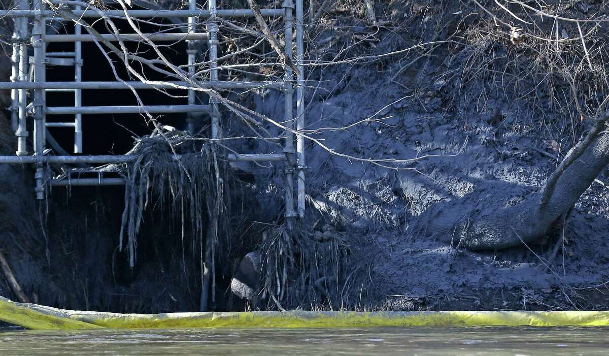A pipe runs to the Dan River from the Dan River Power Plant, where coal ash spilled in early February. Environmental groups pointed out Thursday that Duke recovered less than 10 percent of the coal ash it spilled.