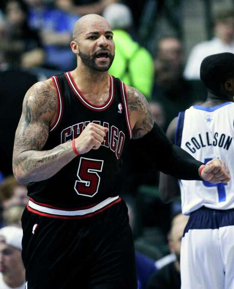 FILE - In this March 30, 2013 file photo, Chicago Bulls power forward Carlos Boozer (5) heads down court after a shot in an NBA basketball game in Dallas. The Chicago Bulls have used the amnesty clause to cut forward Carlos Boozer after four seasons with the team, Tuesday, July 15, 2014.  (AP Photo/Michael Mulvey, File) Photo: Michael Mulvey, FRE / FR170767 AP