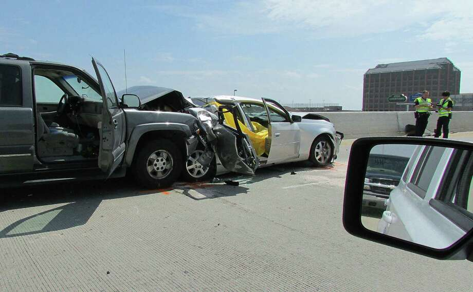 An 87-year-old woman who was a passenger in this Cadillac was killed when the Suburban hit the back of the car, which was being driven by a 59-year-old man, at U.S. 281 and Loop 410, authorities said. Photo: Mark D. Wilson / San Antonio Express-News