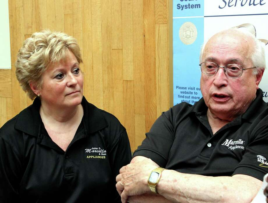 Manager of John D. Marcella & Son Appliances & Home Entertainment Lori Juliano, left, and Owner John Marcella Sr., right, speak to reporters at the Schenectady City Court Thursday, July 17, 2014, in Schenectady N.Y. (Selby Smith/Special to the Times Union)